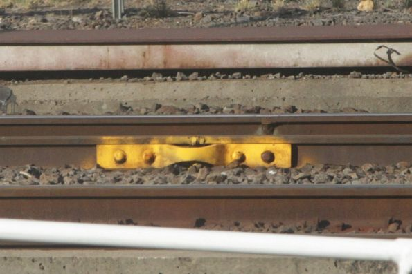 Temporary fishplate attached to a flawed rail outside Southern Cross Station