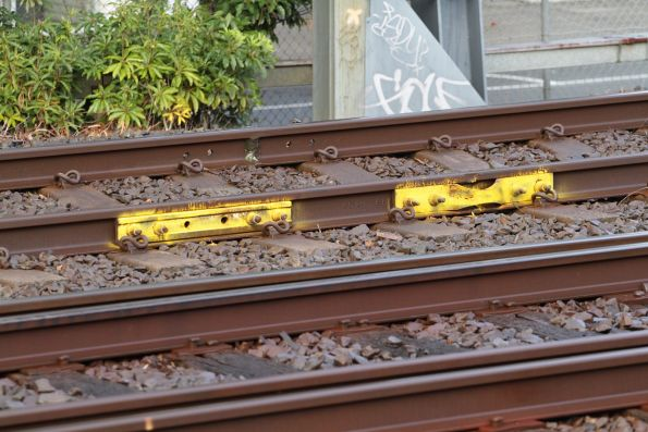 Two of five temporary fisplates affixed to the running rails at the down end of Box Hill