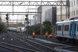 One train has cleared the signal fault at Box Hill, as a second train closes in