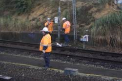 Signalling staff repair a failed trainstop at the city end of Box Hill station