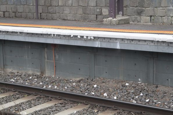 Broken off pieces of rubber platform facing at Heyington station
