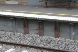 Steel reinforcement for a crumbling concrete platform face at Darling station