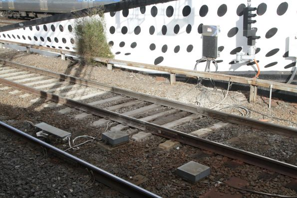 Mud hole in the tracks at the down end of Richmond station