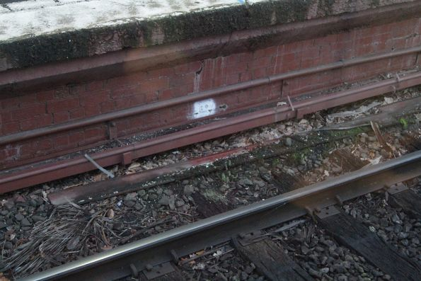 Signal trunking at Camberwell station, filled with dirt and minus covers