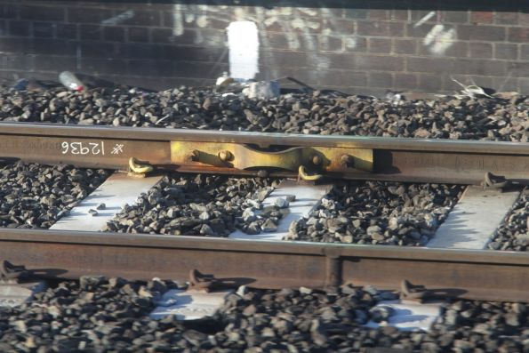 Temporary fishplate attached to the tracks at South Kensington