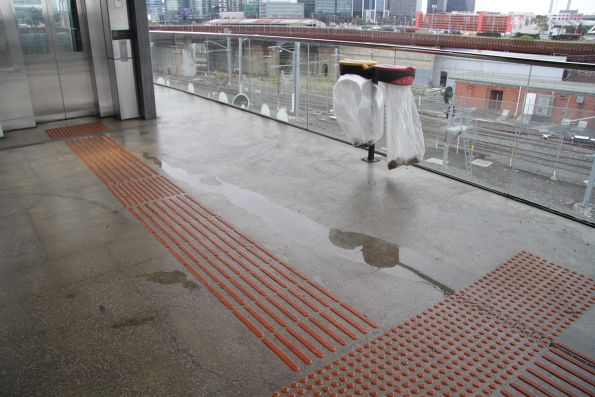 Water pools beneath the inadequate concourse roof at North Melbourne