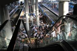 Queues form thanks to a broken down escalator at the Collins Street end of platform 13 and 14