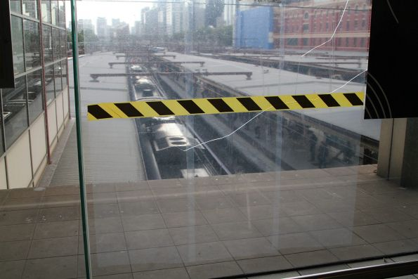 Plastic film covers a cracked window on the Flinders Street Station concourse