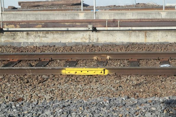 Temporary fishplate bolted to the rails at North Melbourne