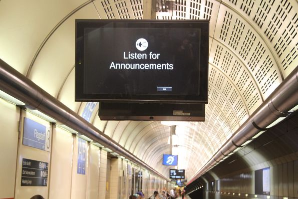 'Listen for announcements' message on a single screen at Flagstaff station