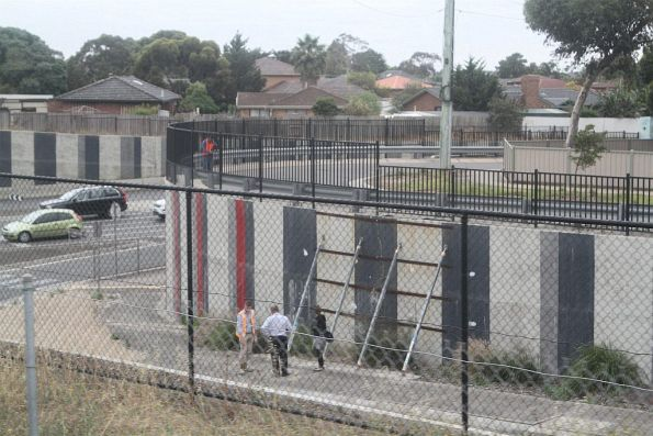 Staff inspect a failing retaining wall at the Taylors Road underpass at Keilor Plains