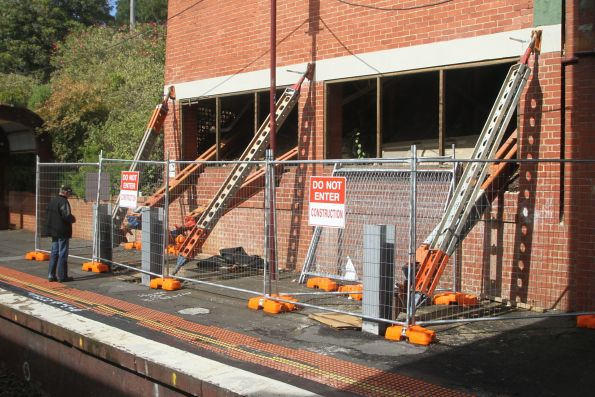 Acrow props support the foundations of the kiosk above Armadale station platform 1