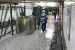 It's a rainy day and the 'caution wet floor' warning signs are out in the Elizabeth Street subway