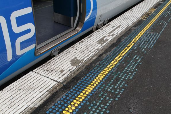 Decaying tactile markers on the platform at Richmond station