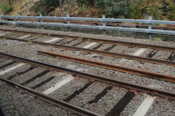 Lengths of flawed rail already replaced, with more rail still to be inserted