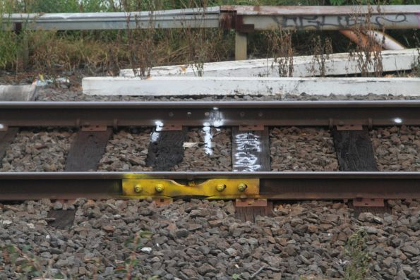 Temporary fishplate affixed to a flawed rail at the up end of Blackburn station