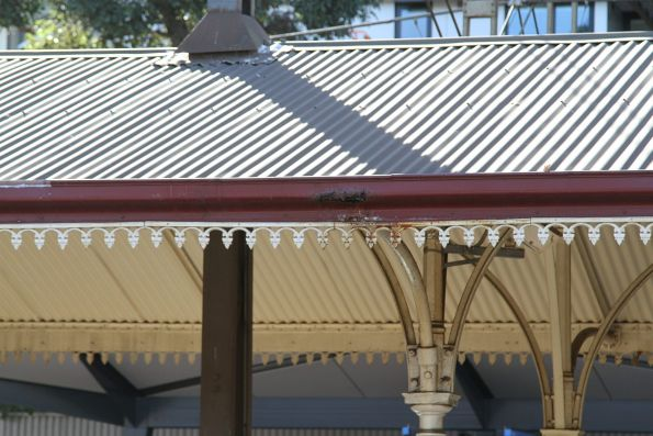 Rusted out guttering at the heritage end of North Melbourne station