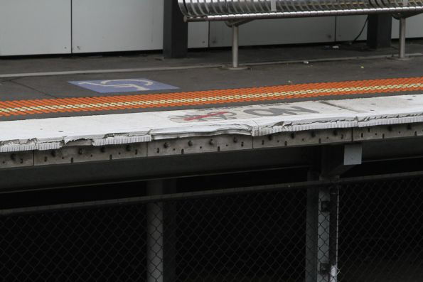 Crumbling rubber platform edge at Springvale station
