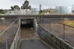 Flooded pedestrian subway beneath the goods lines at Sunshine North