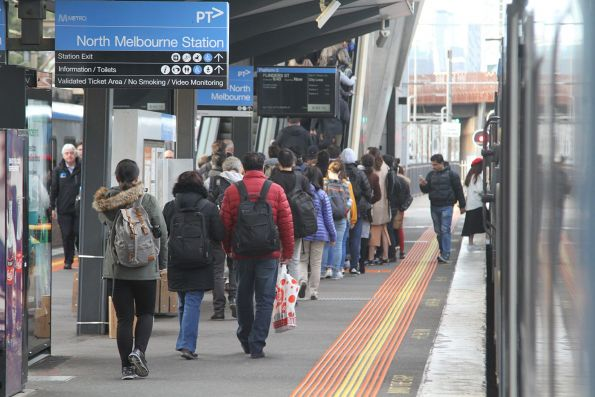 Queue of passengers waiting for the escalator at North Melbourne platform 5