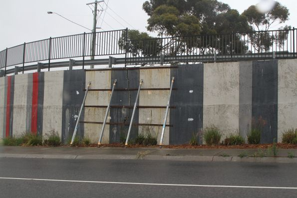 Failing retaining wall propped up in the Taylors Road underpass at Keilor Plains