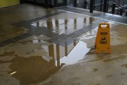 Leaking water covers the concourse at Sunshine station