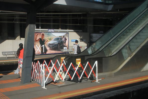 Repairing a broken down escalator in evening peak at North Melbourne platform 2 and 3