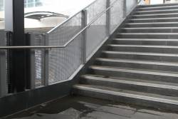 Inadequate roof at Ginifer station means water pools on the stairs down to the platform