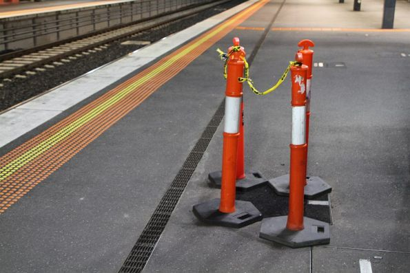 Broken manhole cover roped off at Footscray station