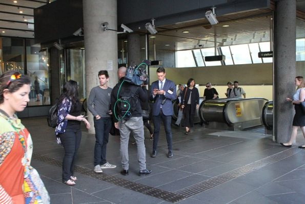 Channel 7 news crew outside the entrance to Flagstaff station