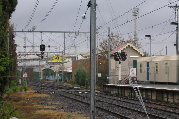 Down end of Showgrounds station on the Flemington Racecourse line, including Showgrounds Junction signal box