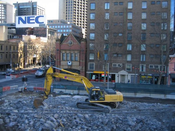 Excavator clearing the remains of the Flinders Street Overpass