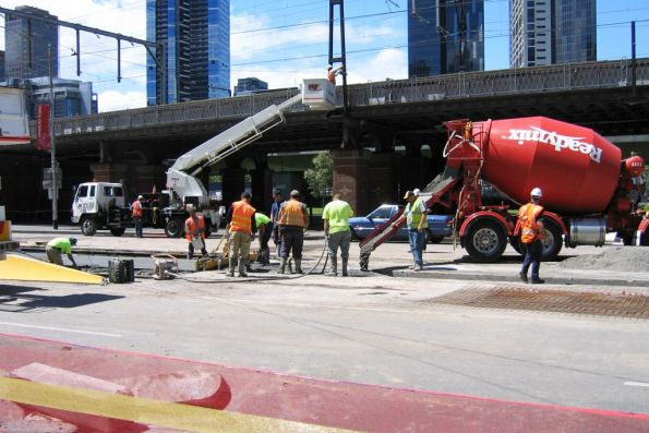 Pouring concrete between the rebuilt tracks at Flinders Street and Market Street