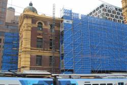 Works elevator in place beside the scaffolding on the southern wall at Flinders Street Station