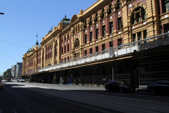 Scaffolding starts to rise on the north-eastern face of Flinders Street Station