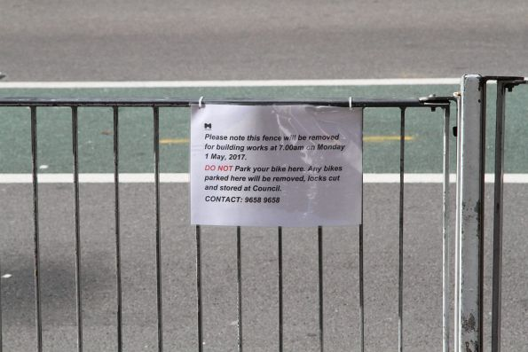 Notice of building works outside Flinders Street Station from the start of May, requiring all bikes to be removed from the fence