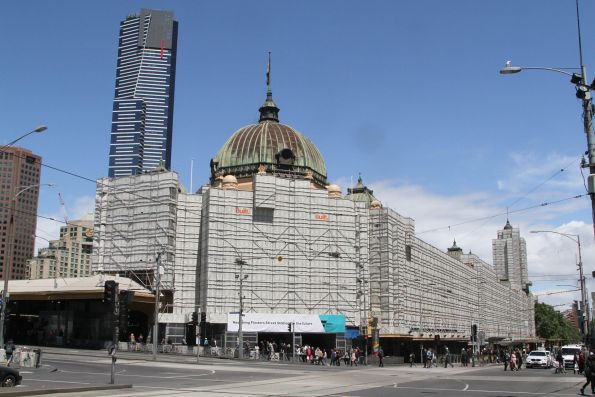 Facade of Flinders Street Station covered with scaffolding