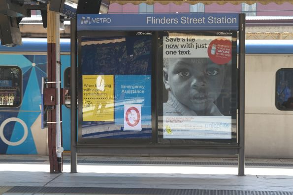 JCDecaux advertising panel marked for removal at Flinders Street Station platform 6 and 7