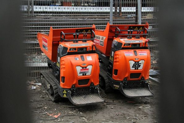 Miniature dump trucks parked in the Banana Alley car park
