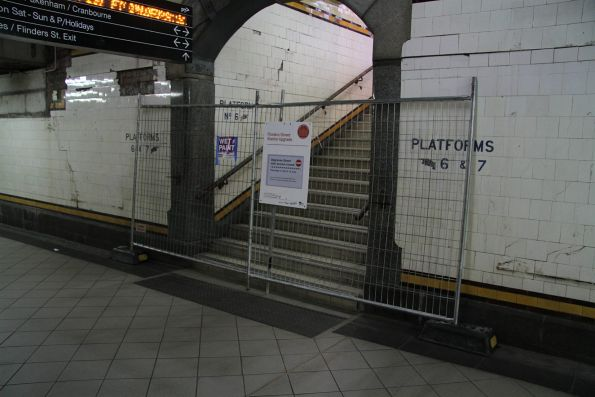 Stairs to platform 6 and 7 closed while the Red Engine kiosk above is being demolished