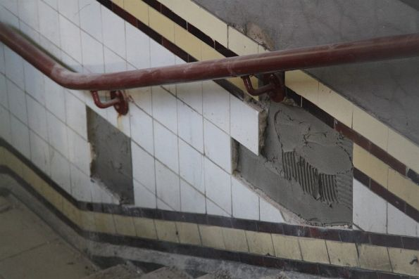 Replacing tiles in the stairs to the Degraves Street subway
