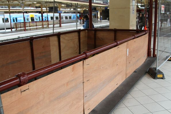 Plywood replaces the stairway balustrades to the Centre Subway during repainting work