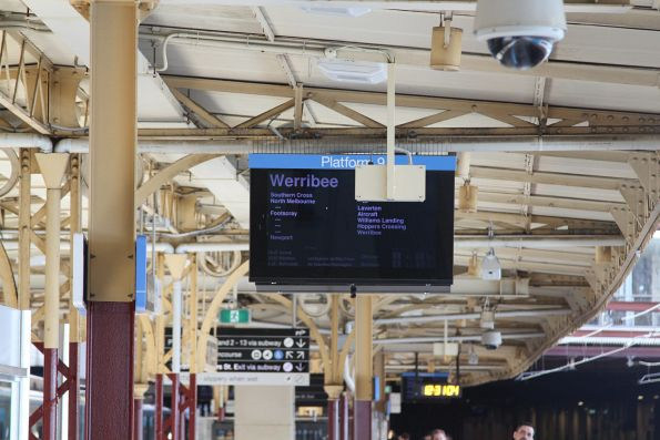 New emergency exit signage blocks the view of the next train displays at Flinders Street Station