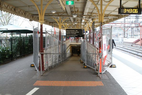 Temporary fencing while the ramps at Flinders Street platform 10 are repainted