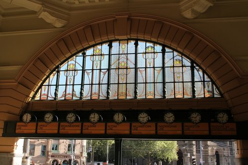 Restored leadlight windows above the clocks at Flinders Street Station