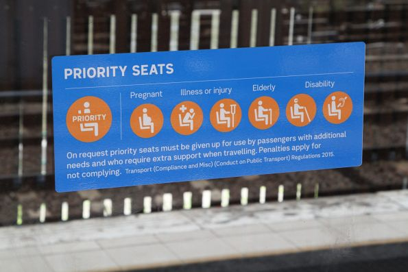 Priority seat signage on the platforms at Flinders Street Station
