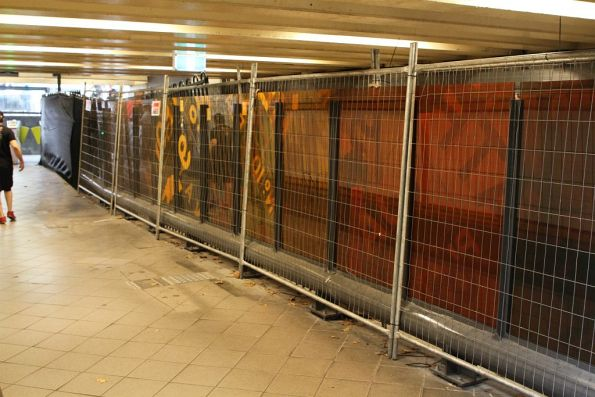 Glass dividing fence still being installed in the Elizabeth Street subway
