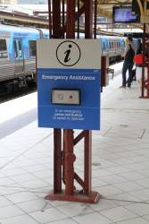 Original style 'Emergency assistance' button panel at Flinders Street Station