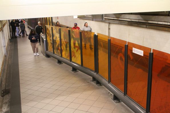 New glass fence between paid and unpaid area in the Elizabeth Street subway