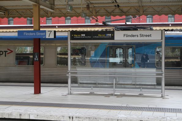 New style signage minus platform numbers at Flinders Street Station
